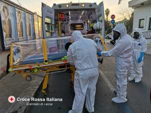 Volunteers from the Italian Red Cross of Lecce preparing to collect a Coronavirus patient